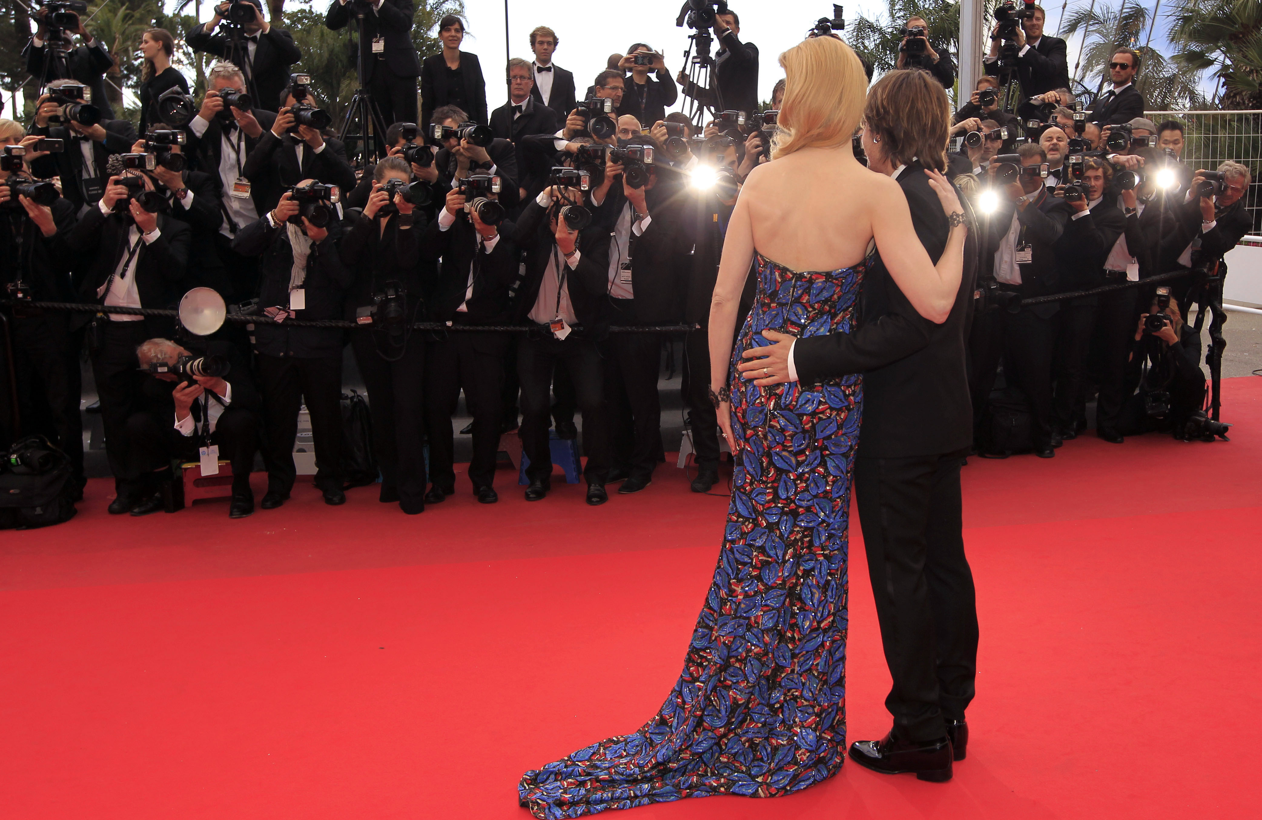 Actress Nicole Kidman, left, and her husband singer Keith Urban pose for photographers as they arrive for the screening of the film Inside Llewyn Davis at the 66th international film festival, in Cannes, southern France, Sunday, May 19, 2013. (Photo by Joel Ryan/Invision/AP)